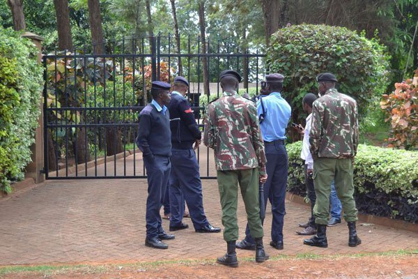 officers guard muringi home