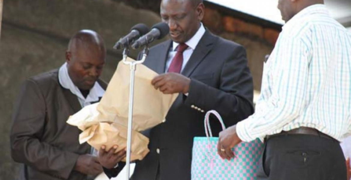 Image result for ruto donating money to church