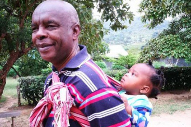 Photo of Makueni Governor Prof Kivutha Kibwana Carrying Child on His Back Goes Viral Online