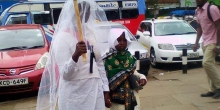 Woman Carries Placard in Streets of Nairobi in Search of Husband